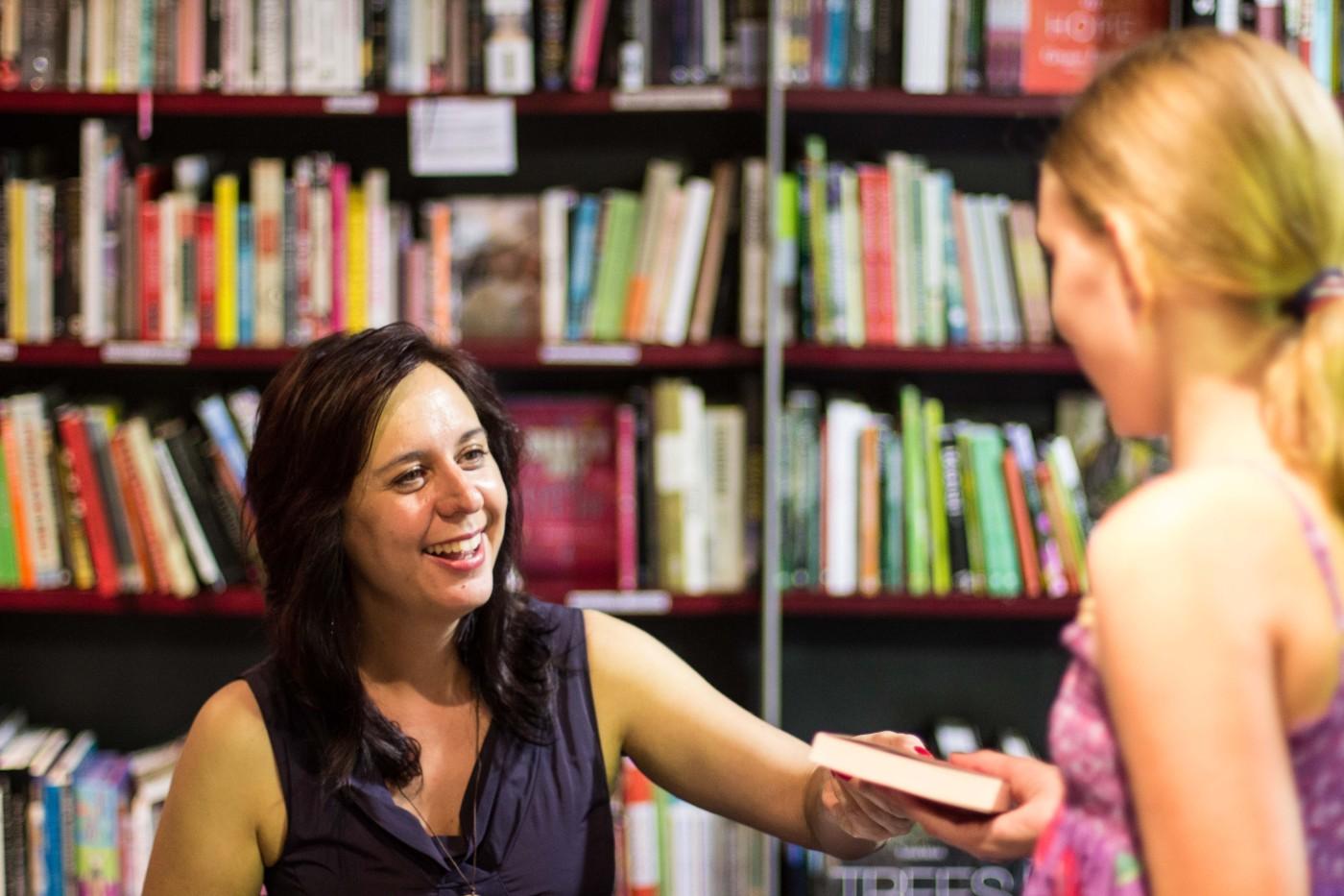 Belinda Jeffrey signing One Long Thread for a fan