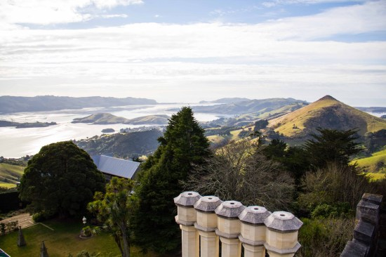 Looking down the Otago Peninsula towards the ocean, from the tower of Larnach Castle, on a hazy day