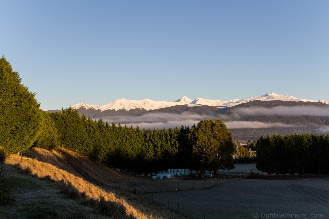 looking from our accommodation towards Lake Te Anau (screened by the trees), with the mountains behind